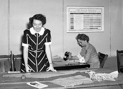 Vintage shot of woman at the cutting table.